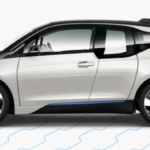 Side-view of 2019 BMW i3 electric car in capparis white color against a white background.