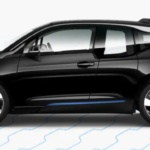 Side-view of 2019 BMW i3 electric car in fluid black metallic finish against a white background.