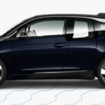 Side-view of 2019 BMW i3 electric car in imperial blue metallic finish against a white background.