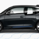Side-view of 2019 BMW i3 electric car in mineral grey color against a white background.