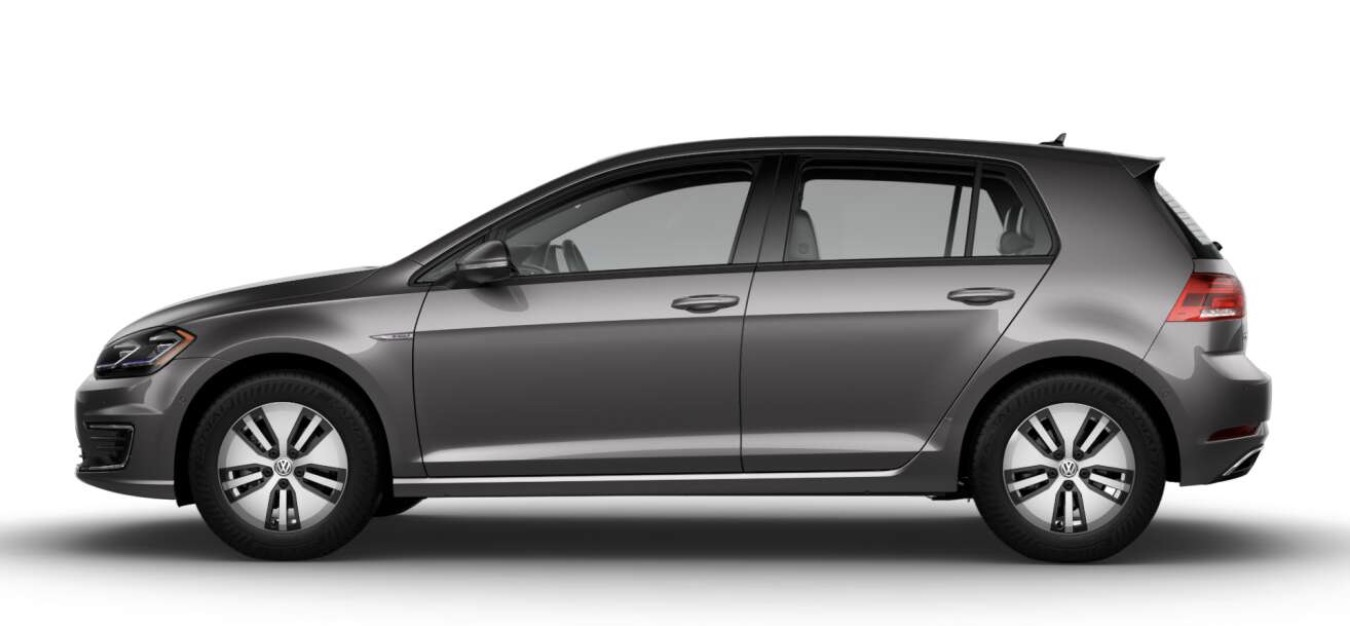 Side-view of Volkswagen 2019 e-Golf electric car in indium gray metallic color against a white background.