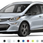 Front-angled view of 2019 Chevy Bolt electric car in silver ice metallic finish against a white background.