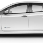 Side-view of Nissan 2019 Leaf electric car in two-tone pearl white tricoat and super black against white background.
