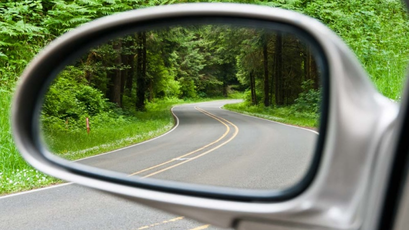 Looking at a forested road in the review mirror: a good way to see just how far electric vehicles have come!